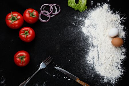 Pizza ingredients on a black background. High quality photo Archivio Fotografico