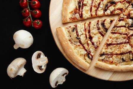 Pizza with ingredients on a black background. High quality photo Stok Fotoğraf
