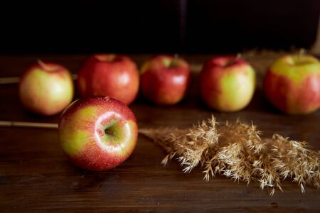 Red apples on a brown table. High quality photo 免版税图像