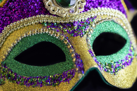 Jester mask up close against black background. Stock Photo