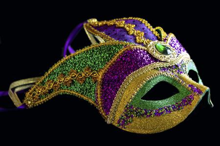 Jester carnival mask side view on black background. Imagens