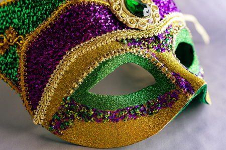 Jester eye mask up close on grey background. Stock Photo