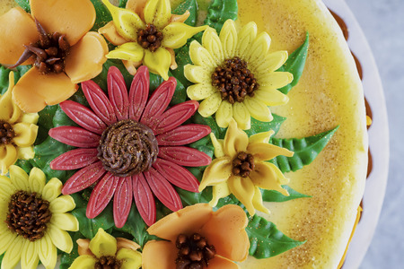 Fondont flowers on a cake.  Top down view.  Flat lay.