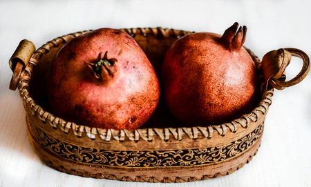 Basket with pomegranates Stock Photo