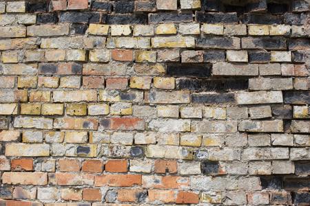 Damaged brick grunge multi colored wall background.