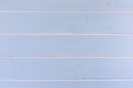 Light blue wooden background with white stripes.