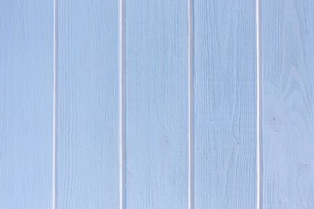 Light blue wooden background with white vertical stripes.