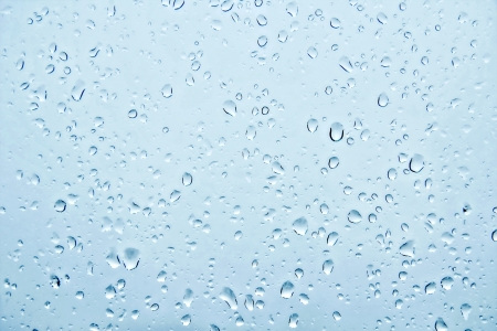 grey water: Water drops on the glass