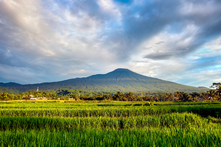 Slamet Mountain in the morning. Clouds hovering over the mountain in a rural area of Indonesia