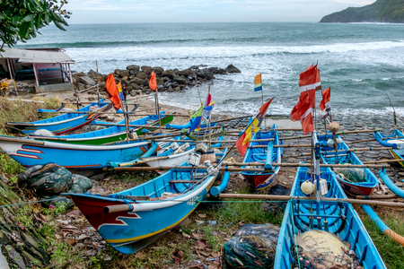 Group of blue traditional fisherman boats, parking on the beach