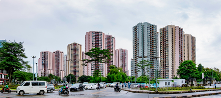 Row of apartement housing in Jakarta, Indonesia in front of traffic