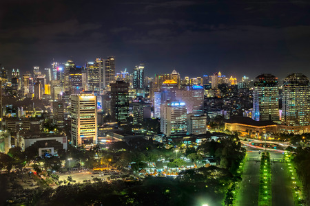 Beautiful skyline of Jakarta city, Indonesia showing skyscraper buildings from top, aerial view at night.