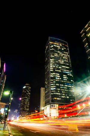 Light trail of busy traffic in front of Jakarta's skyscrapper.  Urban Skyline, Building Exterior, Capital Cities