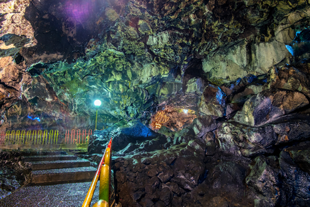 Beautiful cave floor and colorful cave wall in cave passage, illuminated by lamp,  Captured from Lawa cave, Purbalingga, Indonesia. Editorial