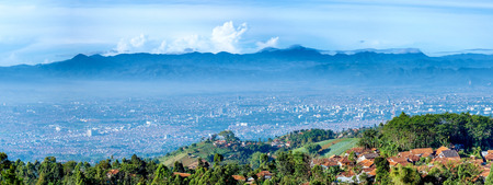 Panorama view of little village on top of the hill and scenery of bandung city from faraway, captured  from Moko Hills when weather is sunny, Bandung, Indonesia