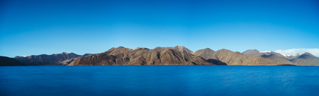 Panoramic shot of Pangong lake with clear sky, Ladakh, India