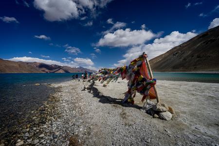 Prayer flags at the shore of Pangong tso (lake), Ladakh, India