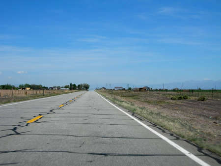Road to horizon in the San Luis Valley with hot, hazy air.
