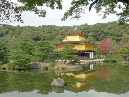 The famous Golden Pavilion (Kinkakuji) in Kyoto,  Japan.  The Golden Pavilion is literally covered in gold - gold leaf. The Golden Pavilion is World Heritage listed and surround by beautiful gardens.  Stock Photo - 4691322