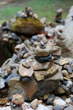 Cairn along a Japanese path with a green, mossy background Stok Fotoğraf