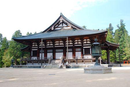 Temple in Koya, Japan, with a stone lantern