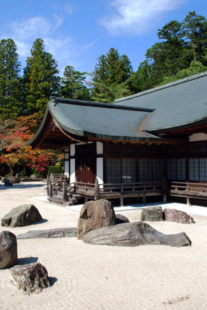 A Traditional Buddhist Rock Garden In Koya-san,  Japan, with colorful leaves and a blue sky in the background Stok Fotoğraf