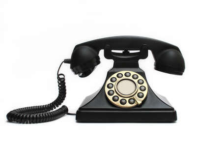 Vintage black telephone isolated on white background photo