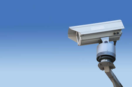 Surveillance camera isolated on blue degradation Stock Photo - 15257490