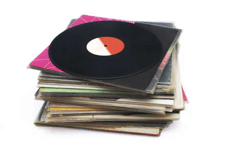 Stack of vinyl record isolated on white background photo