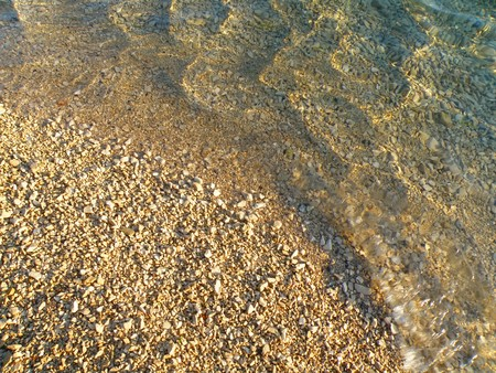 detail of beach - water and small stones in summer Stock Photo - 7387533