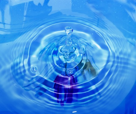 nice macro detail of water drop with blue background Stock Photo - 7565178