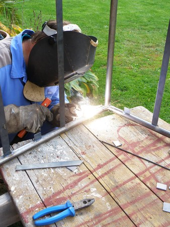 worker site - detail of a man by welding photo