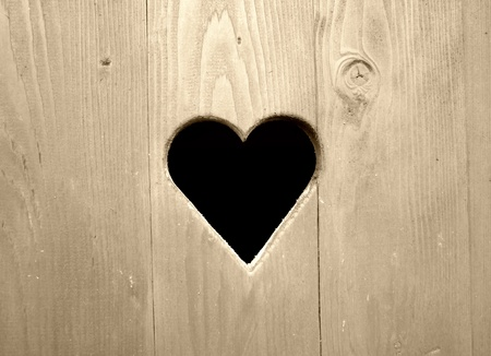 Retro detail of wooden door with heart photo