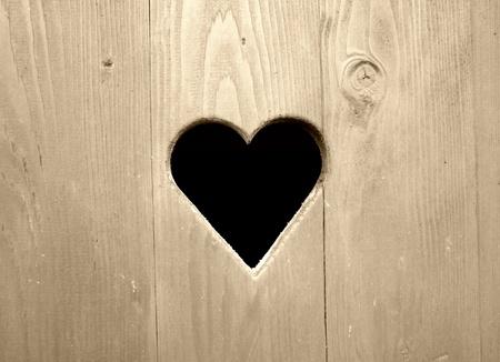 Retro detail of wooden door with heart photo