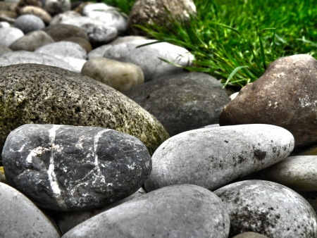 Closeup macro detail of little stones in garden. HDR colorful nature background in summer time. Decoration. Stock Photo - 20162443