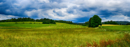 orcia: HDR summer landscape with fields, forests, blue sky with clouds Stock Photo