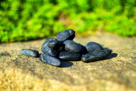 karesansui: Detail of little black stones in zen garden Stock Photo