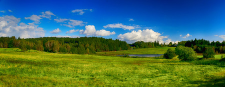 horrizon: HDR summer landscape with fields, forests, blue sky with clouds Stock Photo