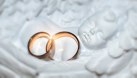 married couples: Two nice wedding rings. Love concept backround. Stock Photo
