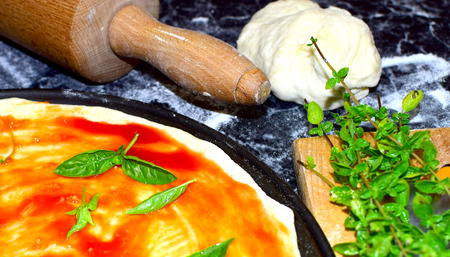 woodfired: Preparation of traditional italian food pizza in kitchen Stock Photo