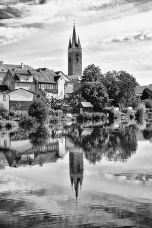 Old town city with lakeside mirror reflection