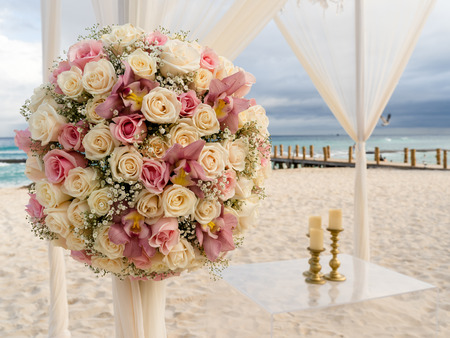 Romantic decoration of a beach wedding on the beach with sea in the background