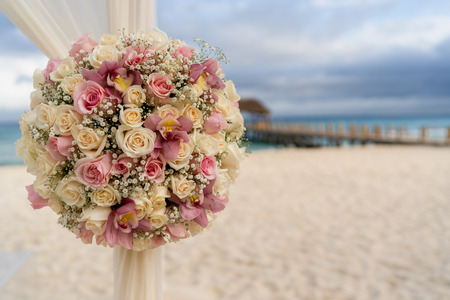 Vintage decoration of a beach wedding on the beach with sea in the background