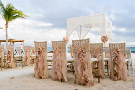 Romantic vintage decoration of a beach wedding on the beach with sea in the background
