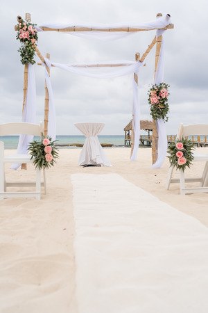 Romantic decoration with pavilion of a beach wedding on the beach with sea in the background