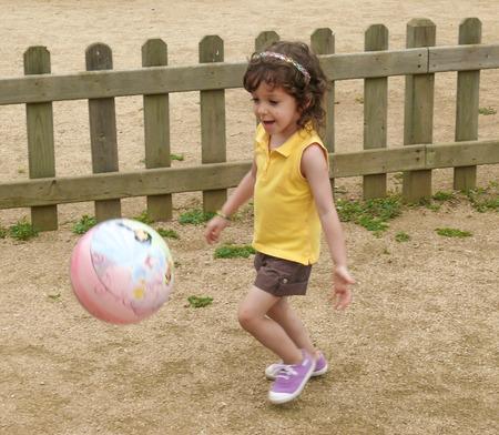 Girl playing ball photo