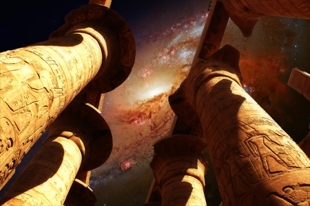 Photo-montage of Karnak Hypostyle hall and Galaxy M106 (Elements of this image furnished by NASA) photo