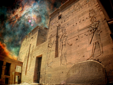 cosmology: Photo-montage of Isis Temple at Philae island and a star-birthing region in the Orion Nebula Stock Photo