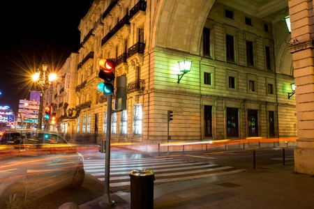 Night photo of long exposure in the city, traffic lights and pedestrian crossing photo