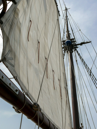 schooner: Close-up of the sail and the mast of a schooner Stock Photo